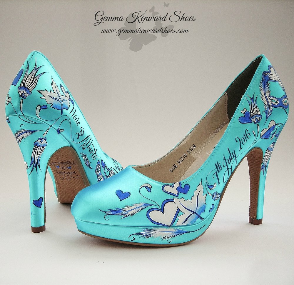 Feathers, hearts and leaves hand painted onto a pair of blue wedding shoes