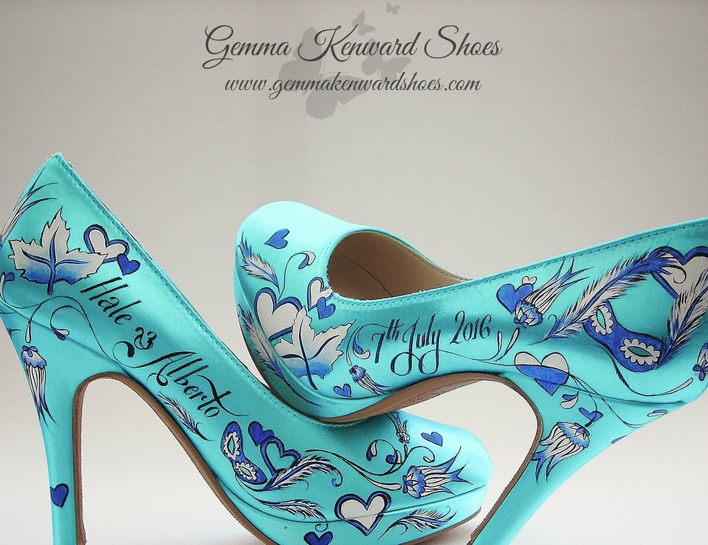 Satin blue wedding shoes painted with a mask with feathers