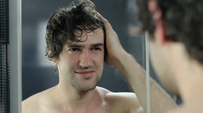 stock-footage-man-wipes-his-hair-with-a-towel-near-the-mirror.jpg