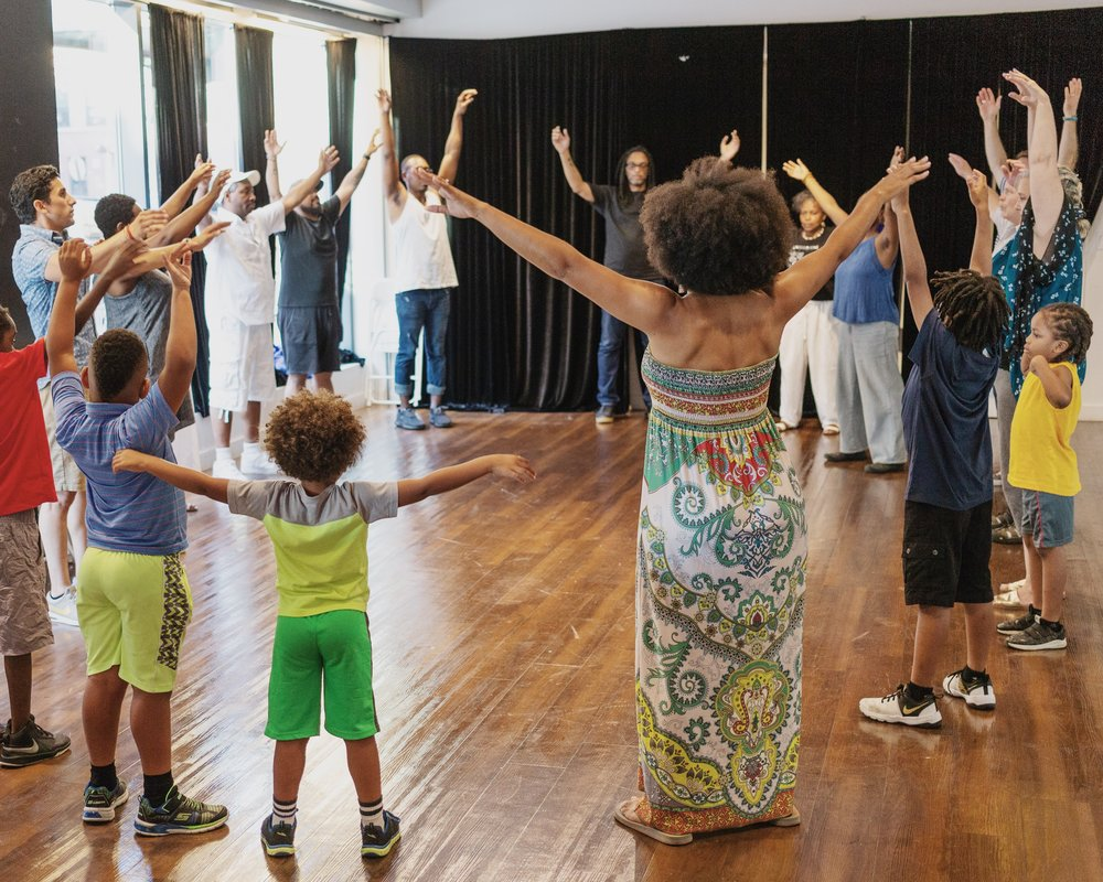 One of seven voice and movement workshops led by artist and musician Goussy Célestin, Photo by Luis Paez. Top banner choir rehearsal photo by Luis Paez.