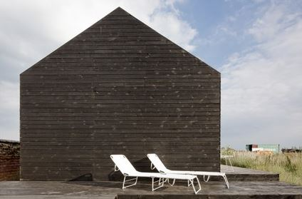 Stealth Barn - an 800-square-foot structure in    Norfolk County, England  with interior clad in OSB wood particle board by     Carl Turner Architects  .      Photographs by Tim Crocker and Jeremy Phillips.