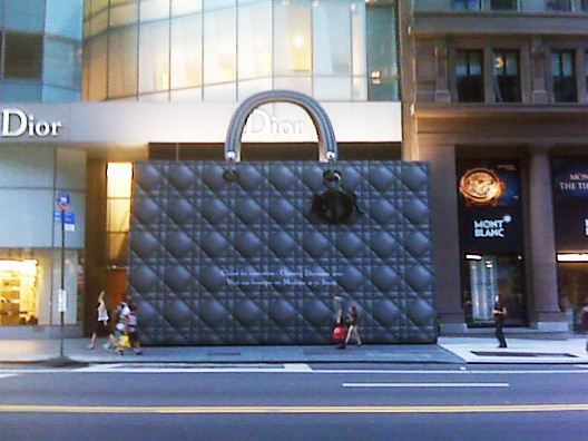 Living in NYC, you come to appreciate a good scaffolding. Something that peeks interest, while not being a complete eyesore. Dior takes it to another level, dismissing the standard plywood and opting for a gigantic Lady Dior bag for their 57th street store. (via Racked)