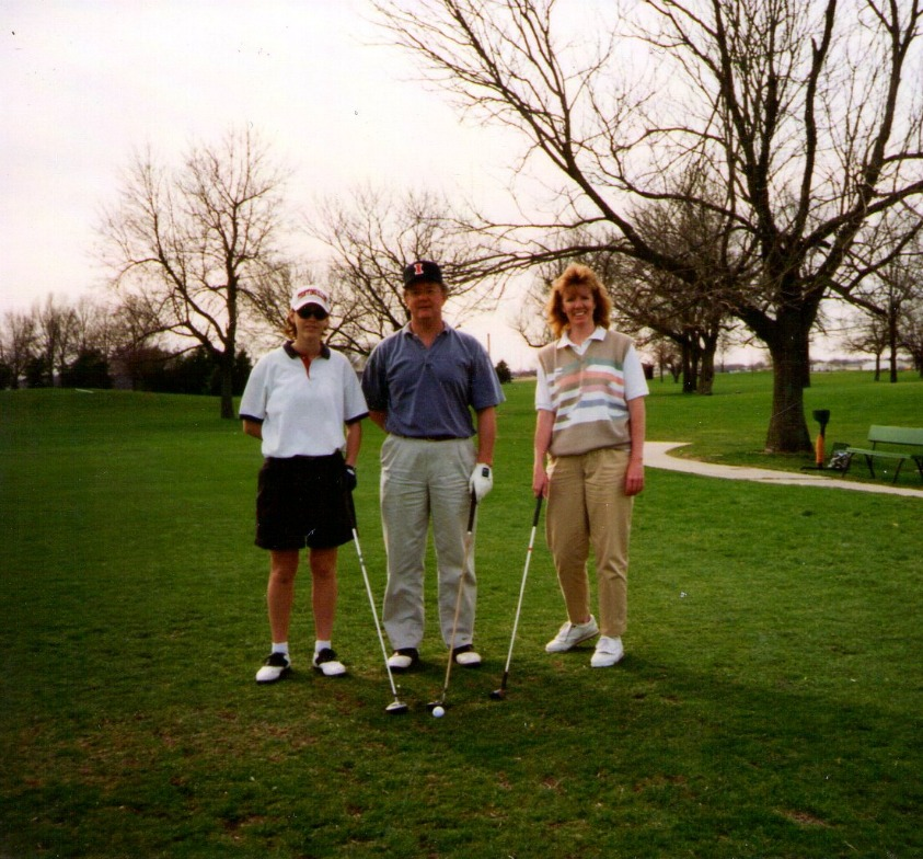 Dad, Carolyn, and I golfing