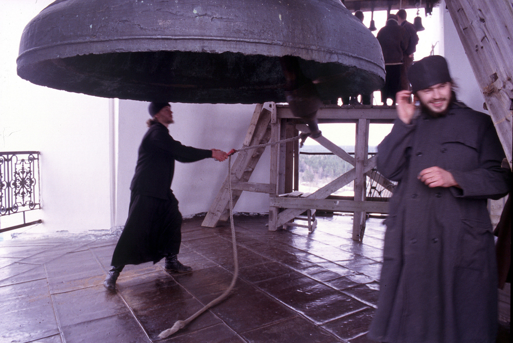 Monks ringing the monastery's bell to mark the end of the Easter service lasting from midnight to 8am.