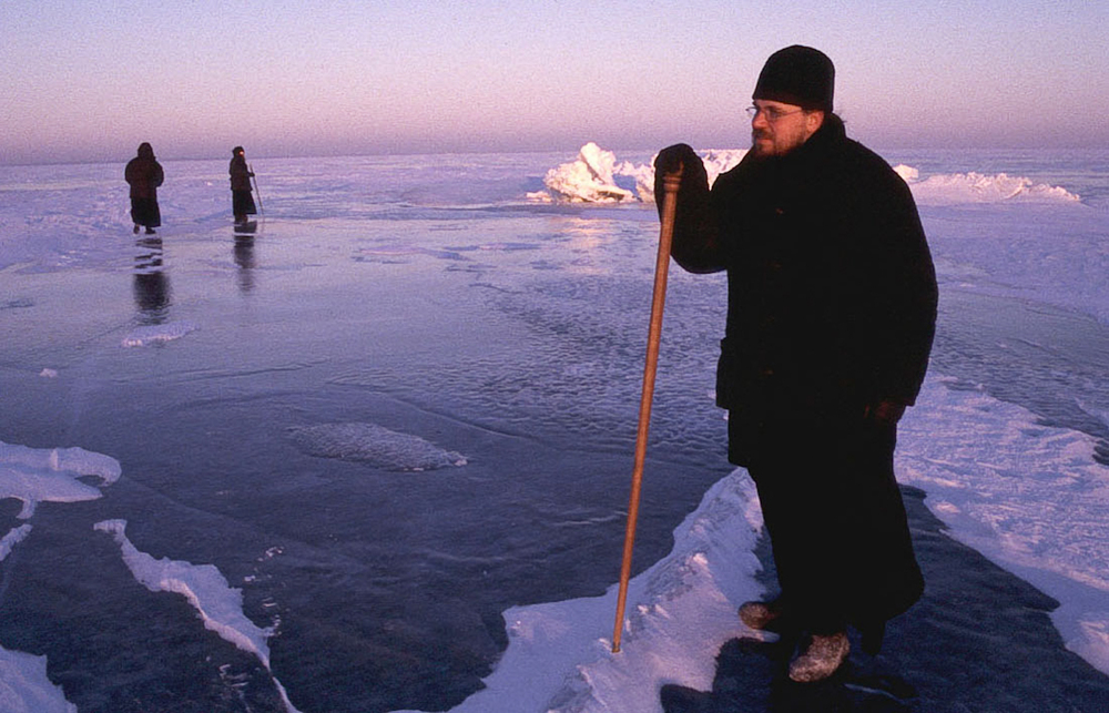 Father Boris testing the thickness of the ice on Lake Ladoga before driving from the island to the mainland to pick up supplies.