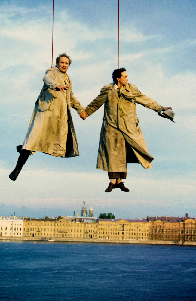 "Actors dangling over the Neva river in St. Petersburg during the making of the Hungarian film  ""A Tale of Two Thieves."""