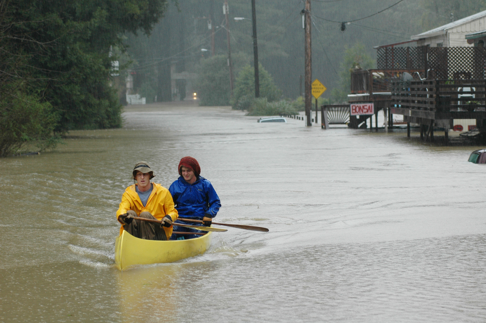 Monte Rio residents canoeing down River Boulevard during the flood of 2005.
