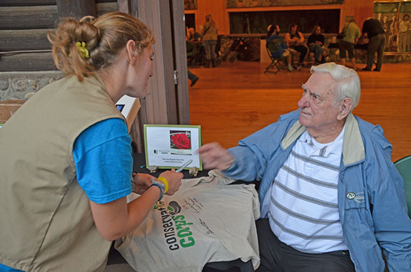 Photo: CCCer Monty Dehn  autographed corps member Holly Wilson's Conservation Corps shirt.