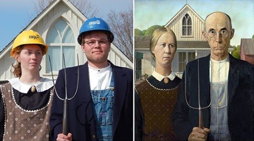 Iowa corps members Sara Anderson and Derek Bean pose in front of the famed American Gothic house in Eldon, Iowa.