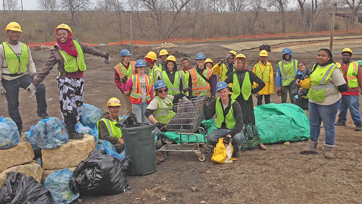 YO crew members with trash picked up at the Trout Brook Nature Sanctuary construction site.