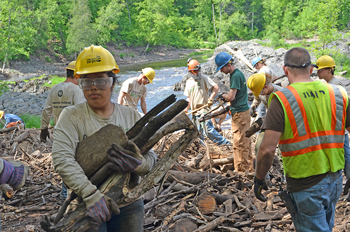Field crew members and SYC participants, including Helen Juarez carrying sticks, worked side-by-side to clear a logjam at Jay Cooke State Park.