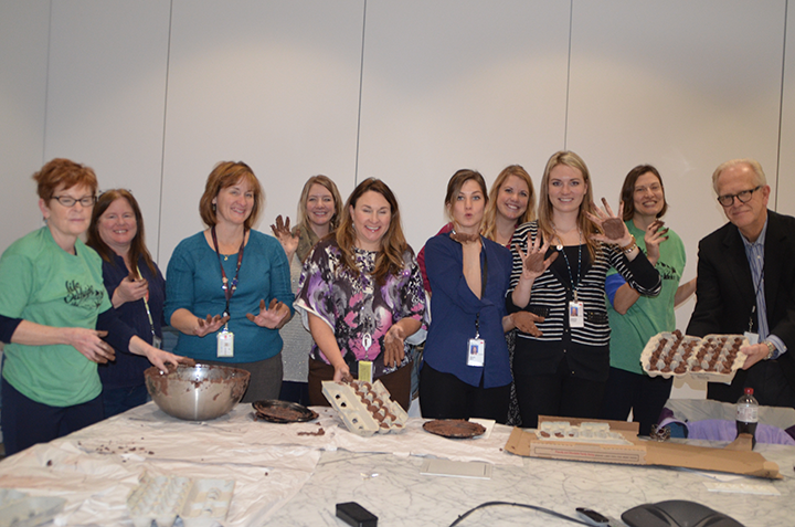 St. Kate's alumni who work at 3M made seed bombs during their lunch hour.