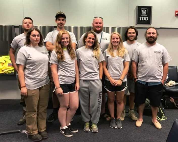 Conservation Corps Minnesota & Iowa members at the airport