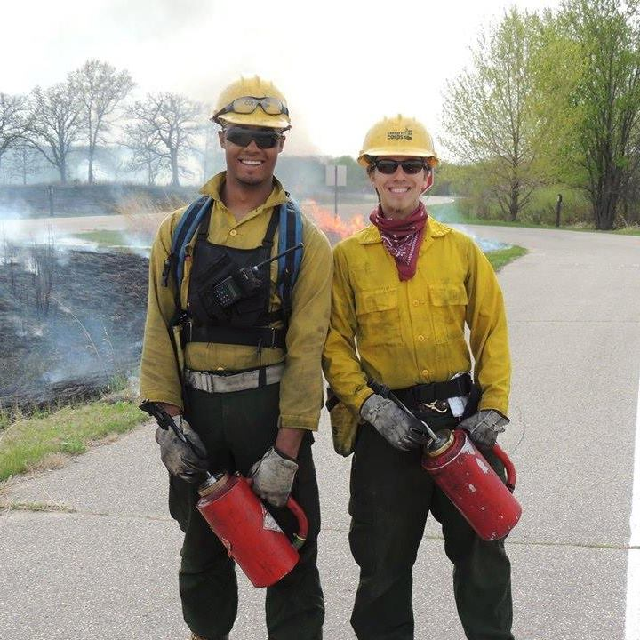 Shane is pictured on the right during a prescribed burn with Conservation Corps.