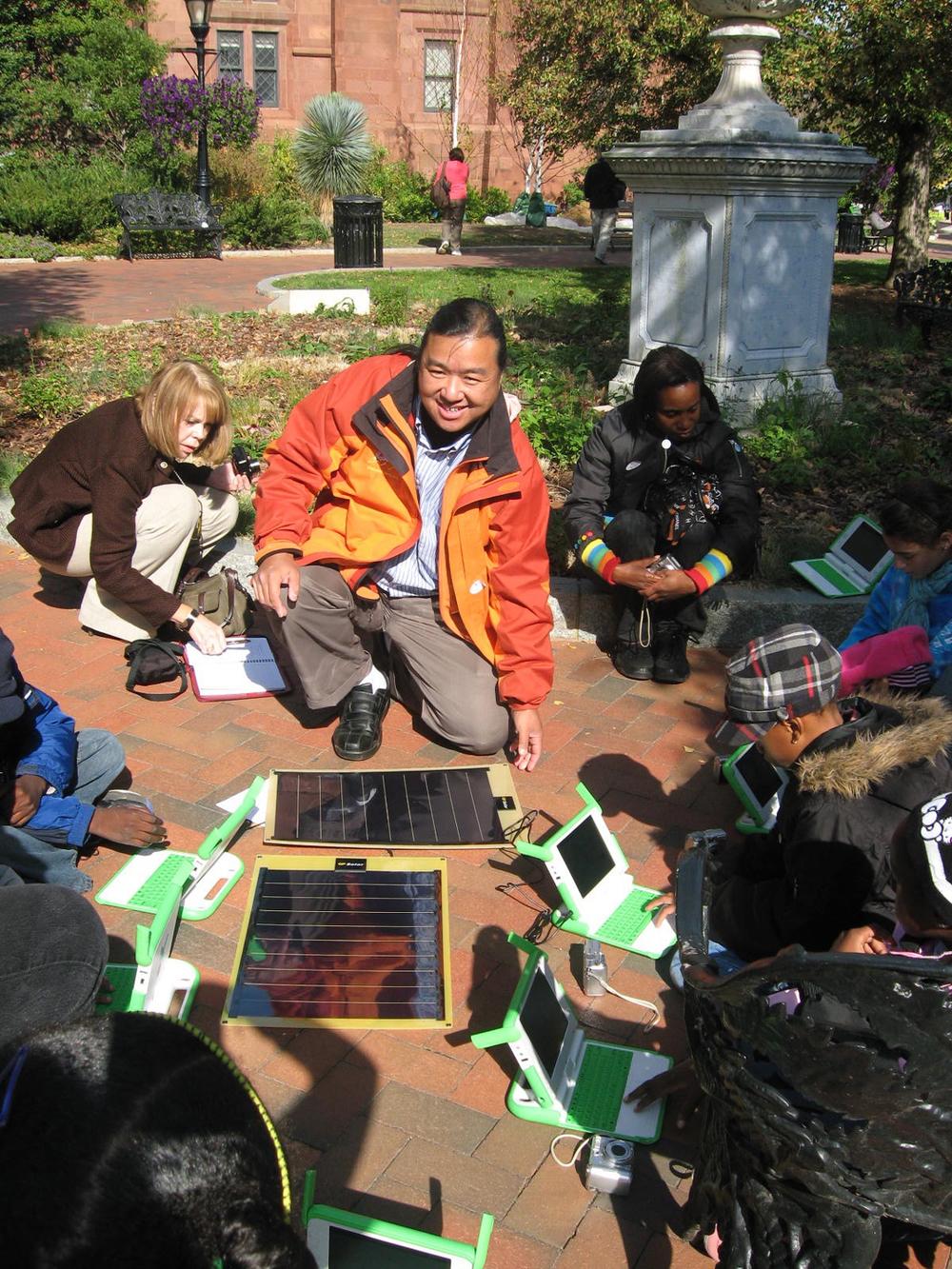 Mike Lee demonstrates solar panels. Photo: ©2010 Joanne Miller