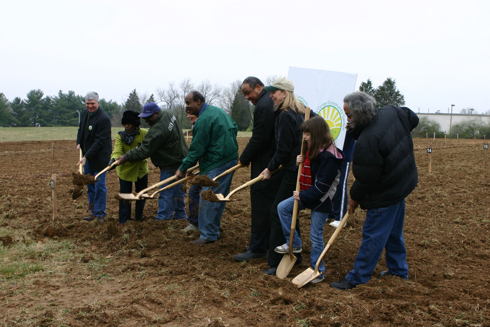 Community members break ground. Photo: ©2011 Joanne Miller