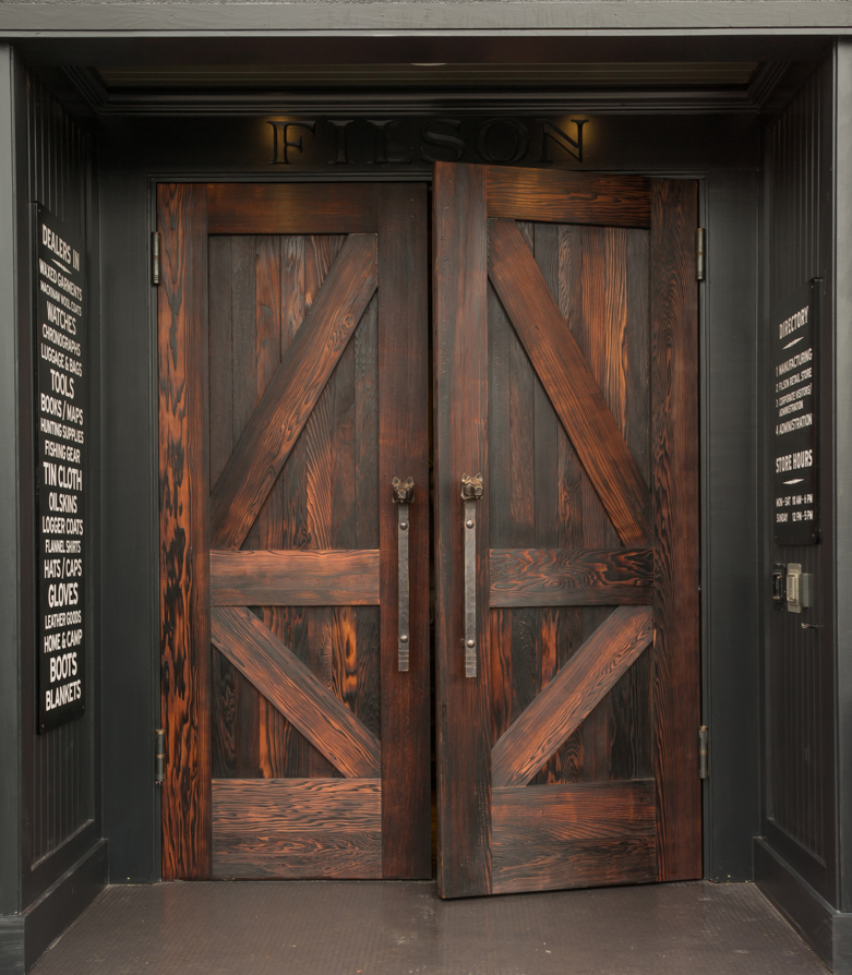 Dovetail's wood shop continues to produce custom designs such as doors, cabinets, kitchens, soaking tubs, and more. The doors here are fabricated out of reclaimed redwood that was then burned and oiled. Photo: Lara Swimmer