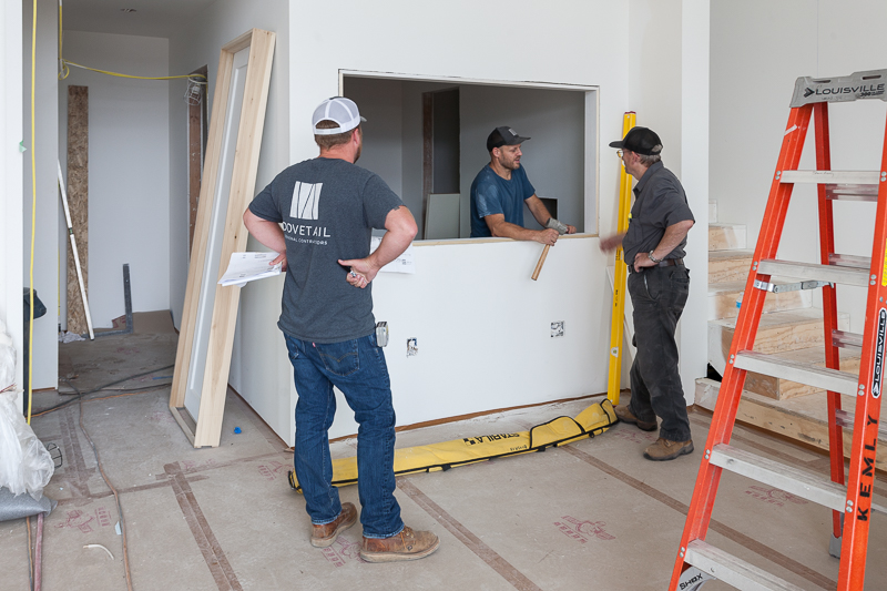 Carpenters frame out an interior window between the living room and recording studio.