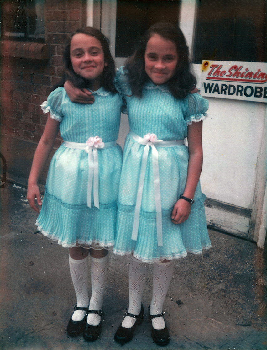 A behind-the-scenes photograph of the twins from The Shining (1980).