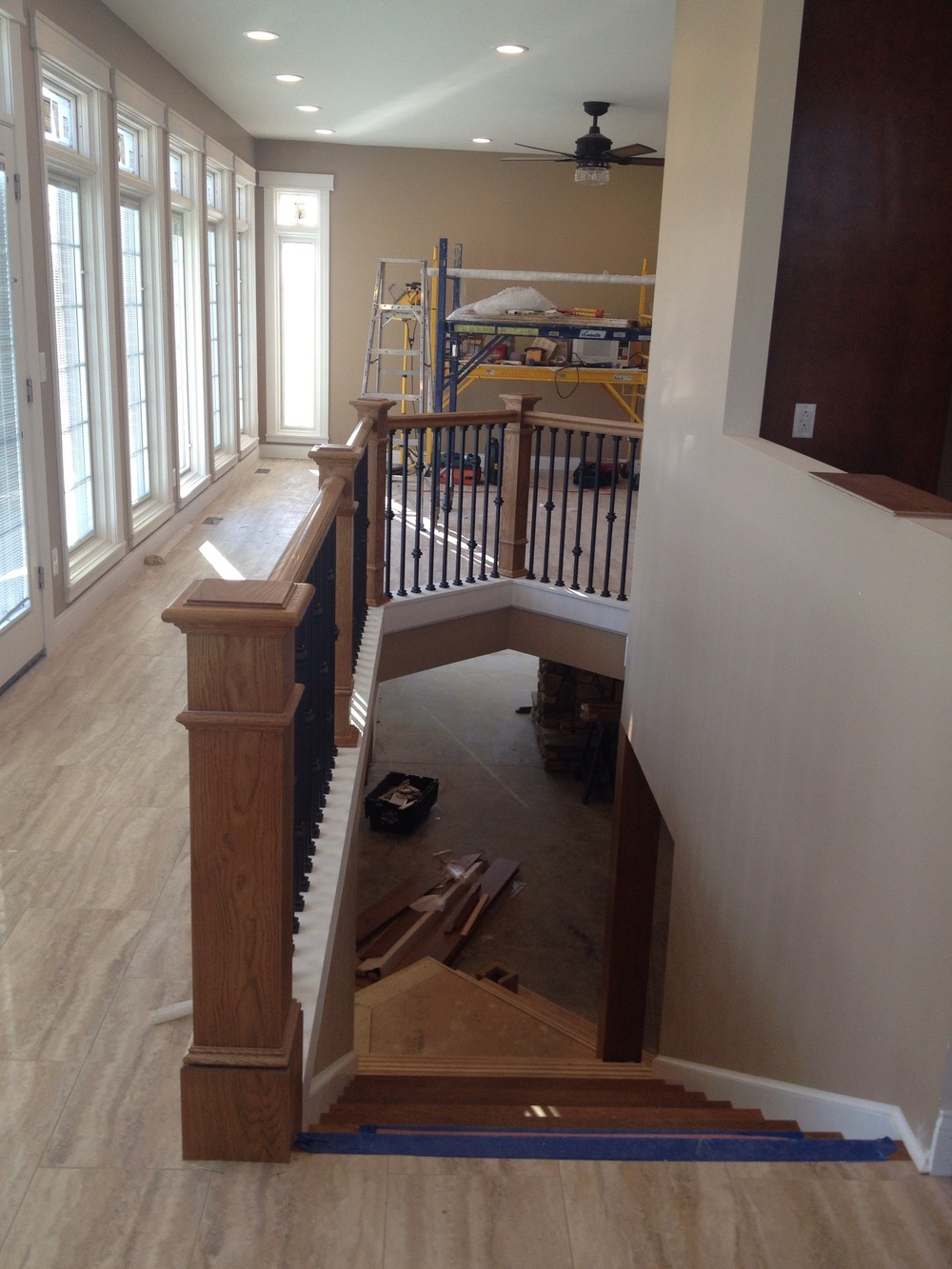 Stairs to the basement between kitchen and sunroom.