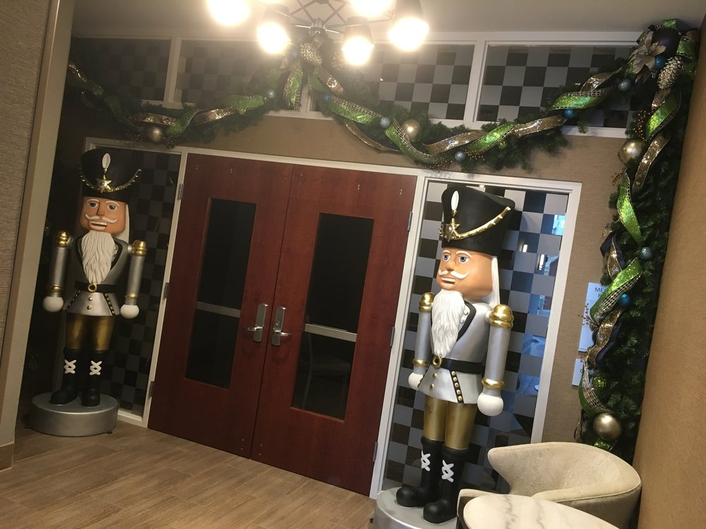 Entrance to Meeting Room. Custom garland and two 6' tall fiberglass nutcrackers.