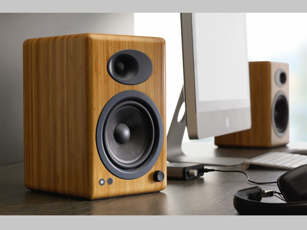 At 7 X 11 X 8 inches, the Audioengine A5+ Powered Speakers fit on a desk yet have plenty enough power to drive even a larger room with stunning Hi-Fi audio performance.  From $399 on iHi-Fi.com.  Compare to speakers costing 10 times more with a 30 day audition.