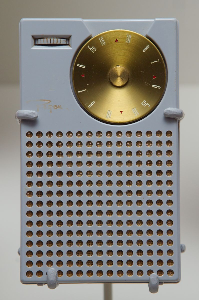 Regency TR-1 transistor radio, the first commercial transistor radio, which debuted October 18, 1954. Designed by Texas Instruments and IDEA, the TR-1 had a superheterodyne circuit with only 4 transistors: a combined local oscillator/mixer, two IF amplifiers, and one audio amplifier. Within one year of release, TR-1 sales approached 100,000. The transistor radio was the most popular communications device in history, with billions manufactured during the 1960s and 1970s. Courtesy of Steve Kushman. https://en.wikipedia.org/wiki/Transistor_radio.