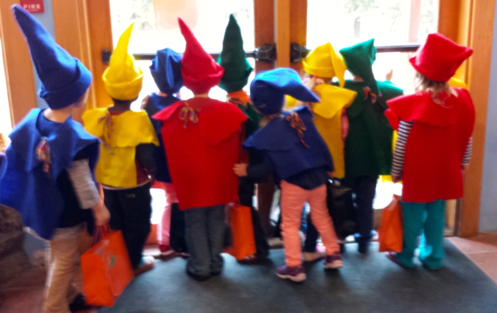 Preschool gnome troupe looking at a squirrel out the window of the big school, Halloween, 2014