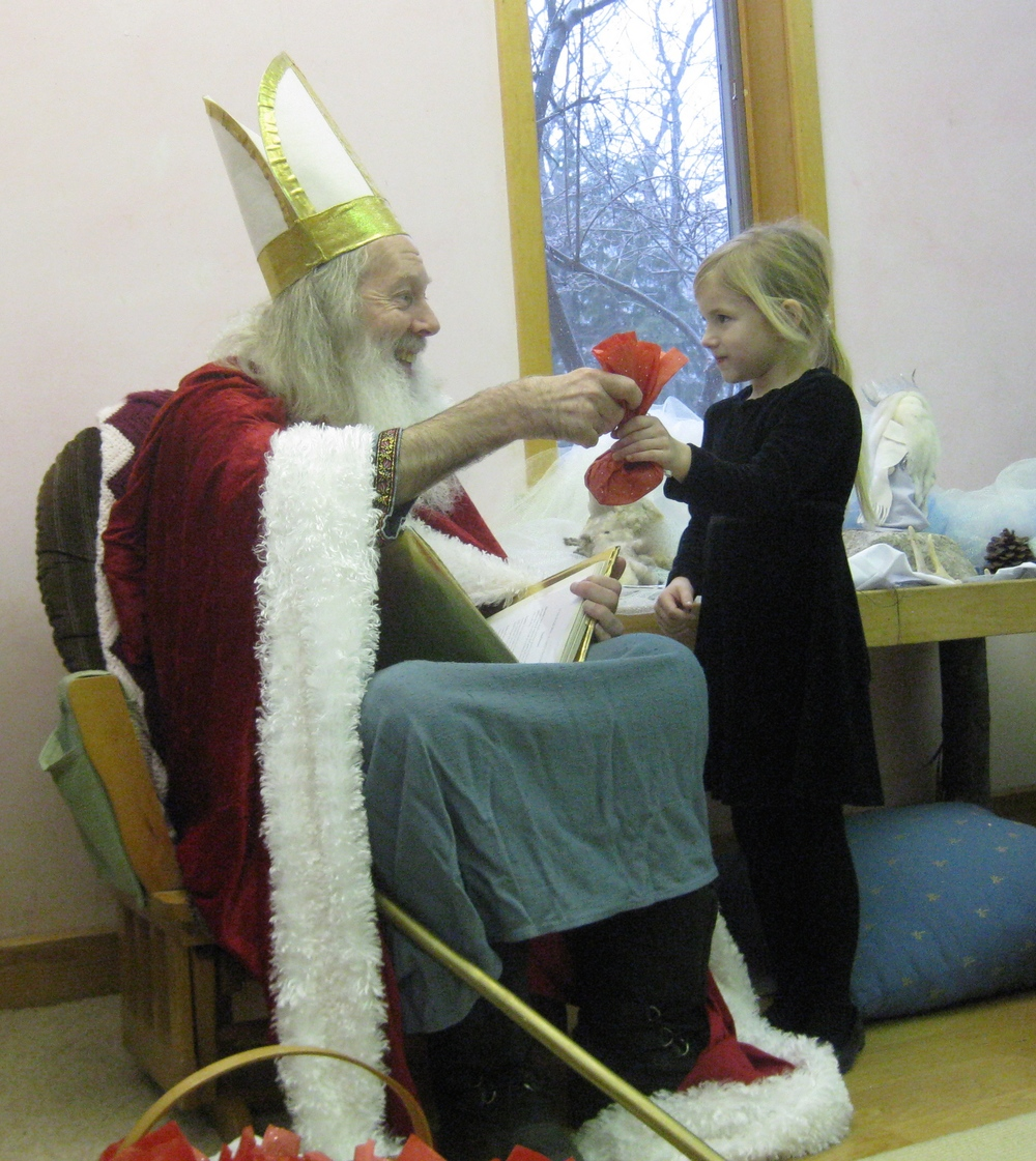 St Nicholas giving her a gift
