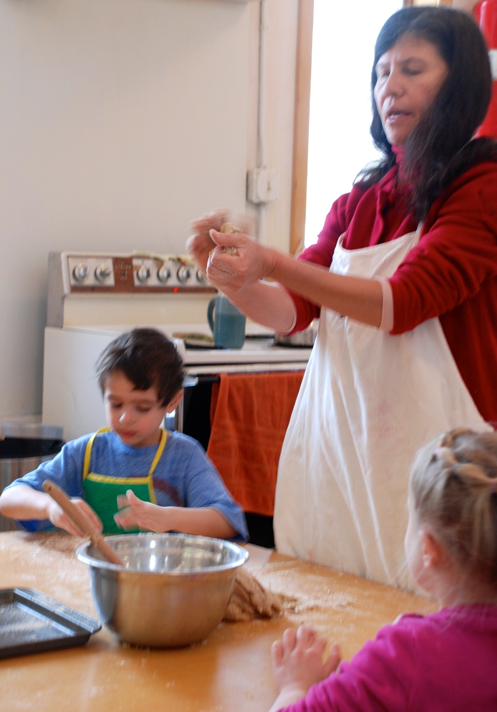 Nutrition & Community:  Baking bread for their morning snack and to share with the toddler class.