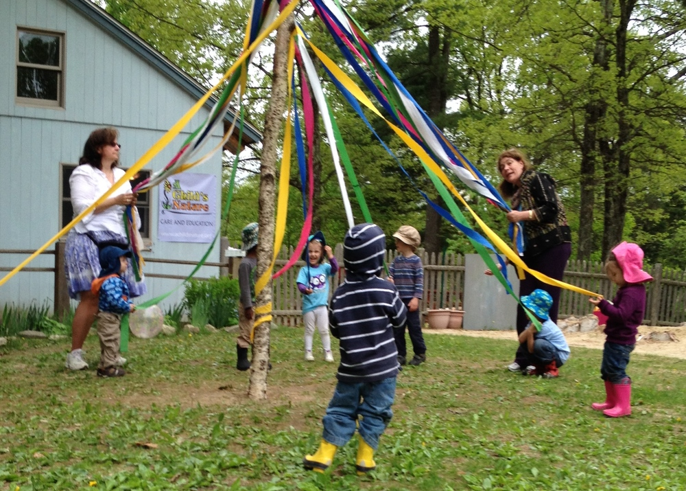 Practicing maypole dances at circle time