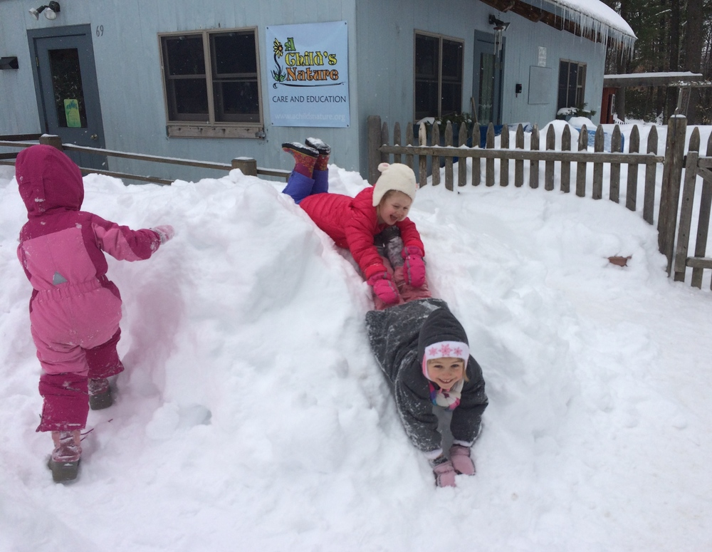 Winter fun together in the Bluebell Cottage play yard