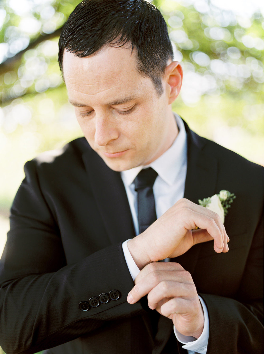 Groom getting ready for wedding