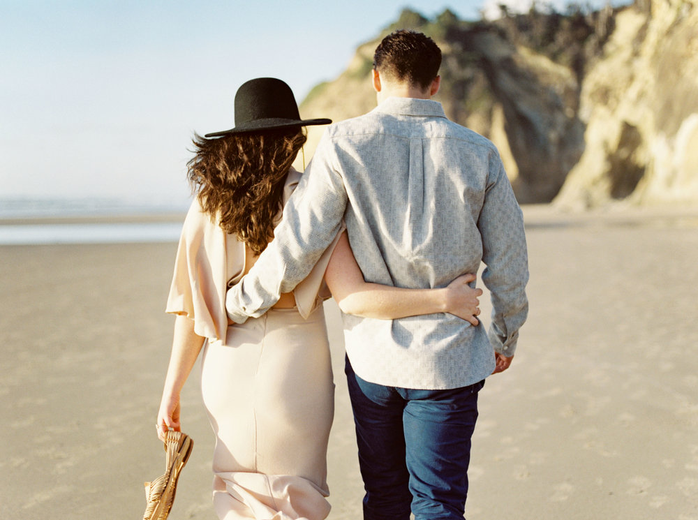 Oregon Engaged Couple Walking on Beach
