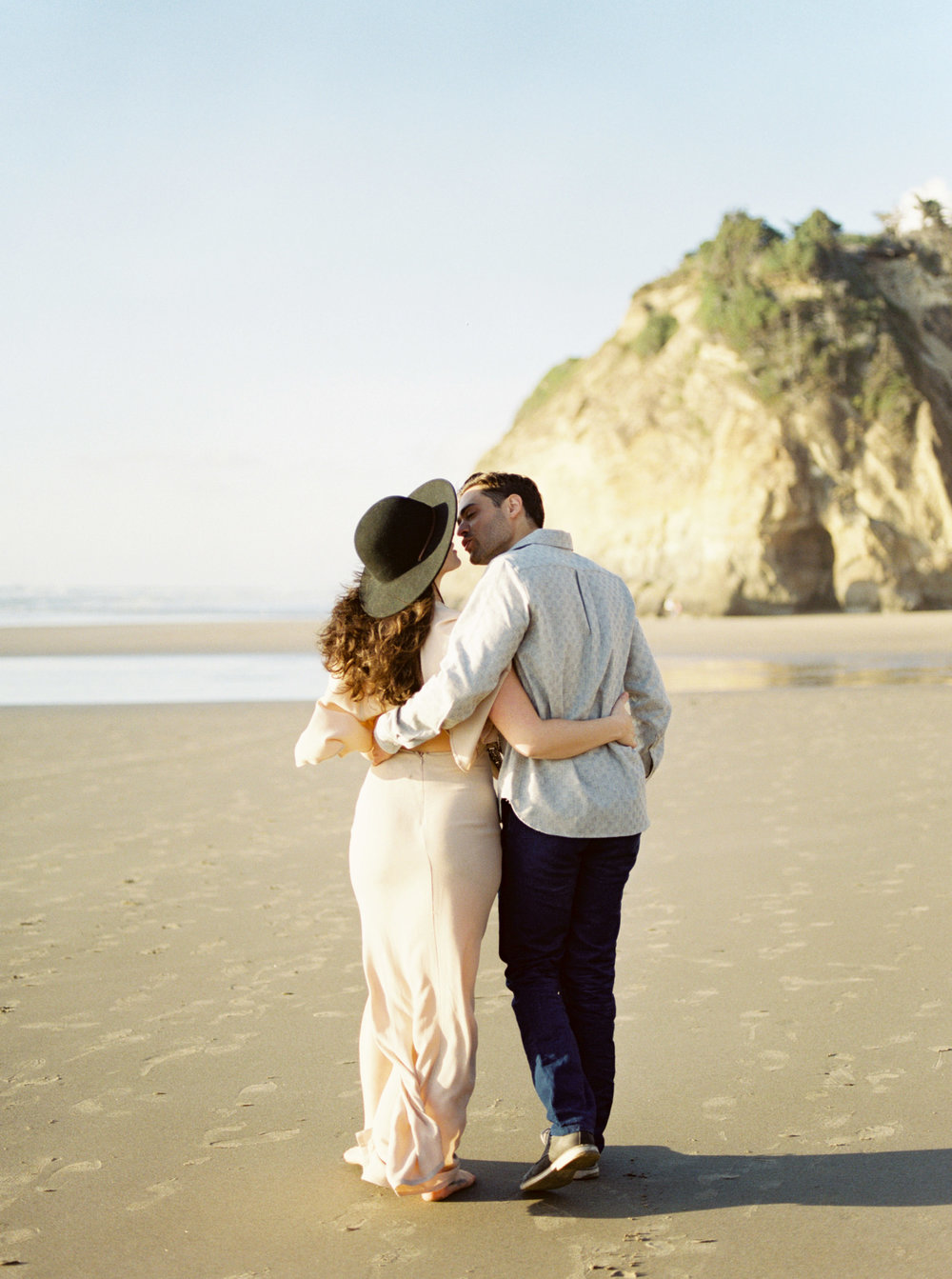 Oregon Couple Kissing on Beach During Engagement Photos