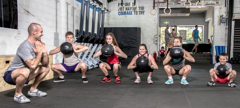 CrossFit Kids- medicine ball squat.jpg