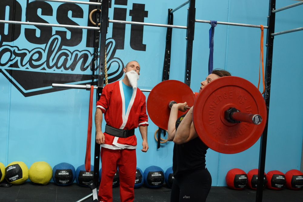 """Above: Coach Benjamin and Rachel during the """"12 Days of X-mas WOD""""! A fun filled day :)"""