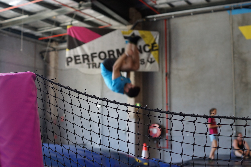 Above: Coach Dylan performing a triple front flip during our recent trip to BOUNCE Inc!