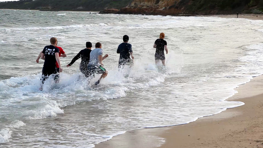 Above: running through the surf, our 2014 ULTIMATE 30 DAY PALEO CHALLENGE participants completing the final mystery challenge at beautiful Half Moon Bay (Black Rock)!