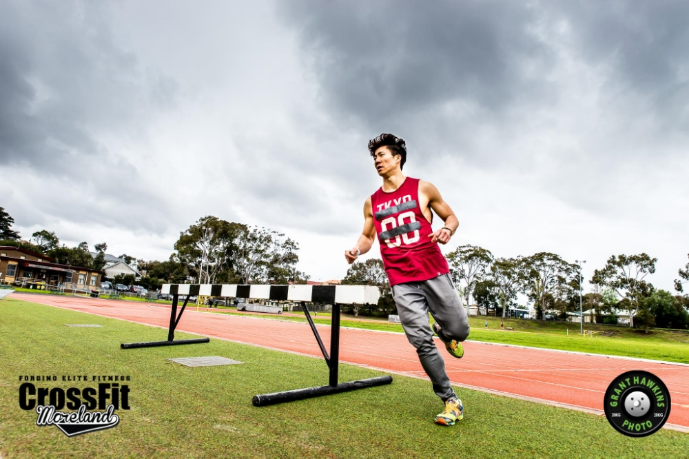 "Above: Coach Sukwon during the infamous WOD ""NANCY"" at Aberfeldie Athletics Track"