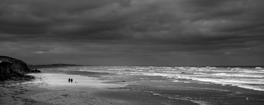 Middleton beach spot light on walkers BW.jpg