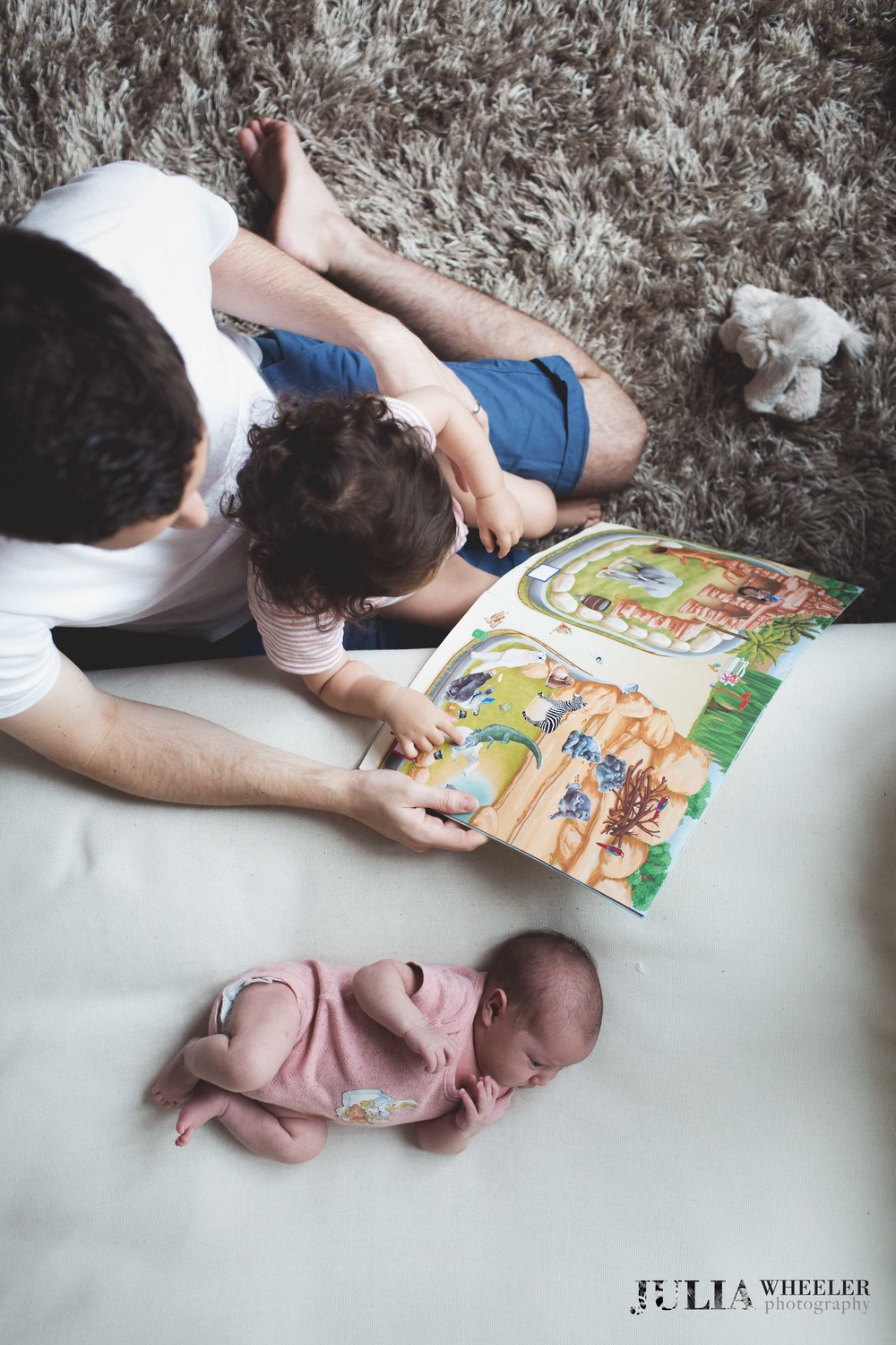 Home newborn session with these guys. I love this shot.