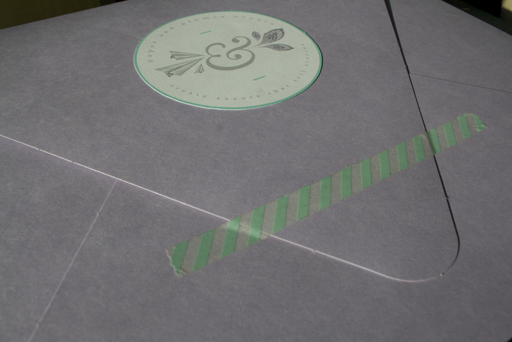 oversized envelope for all paperwork...sealed with washi tape and our logo :)