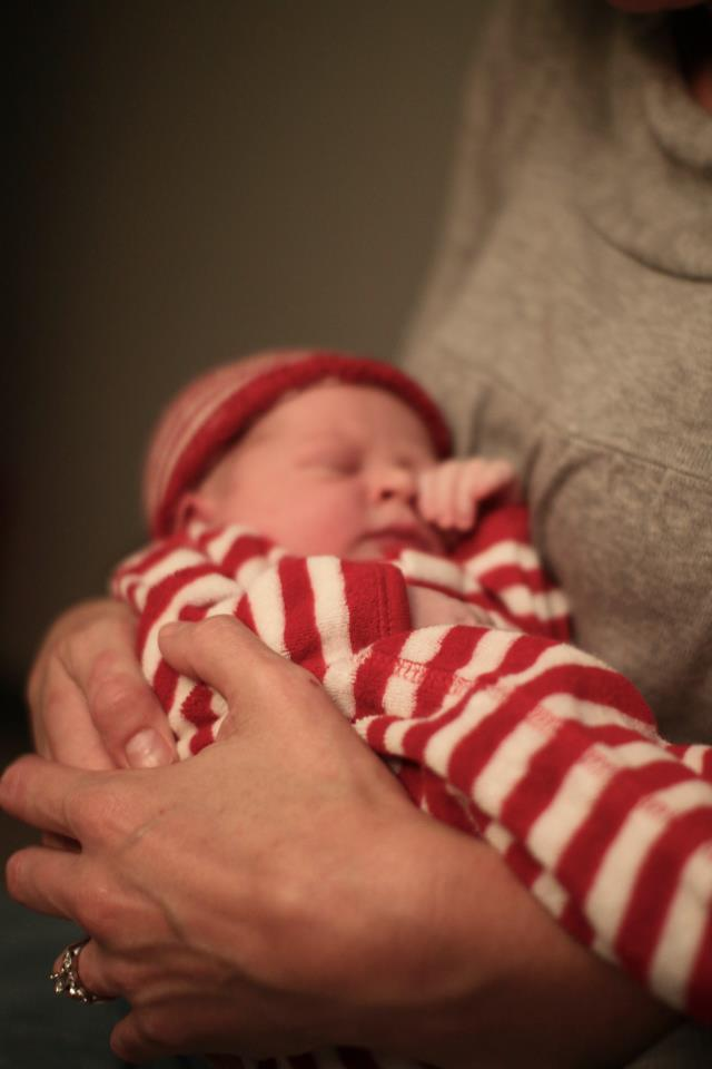 Doula holding newborn baby in Greenfield MA