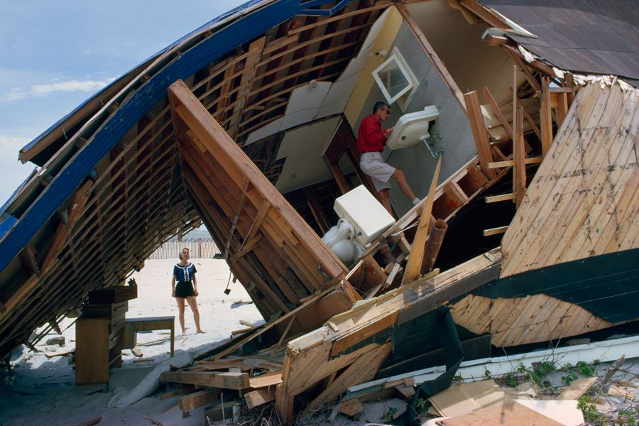 A couple inspects a beach house destroyed after a storm in March 1962.