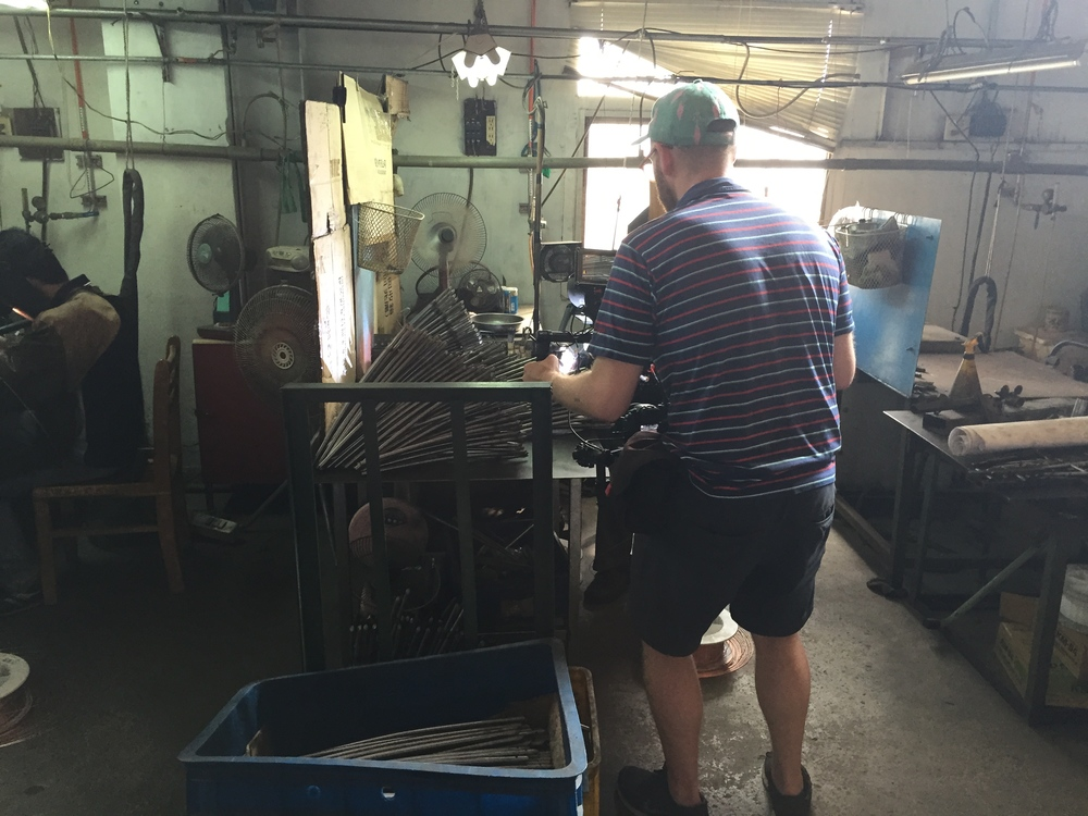 Jacob filming some welding.