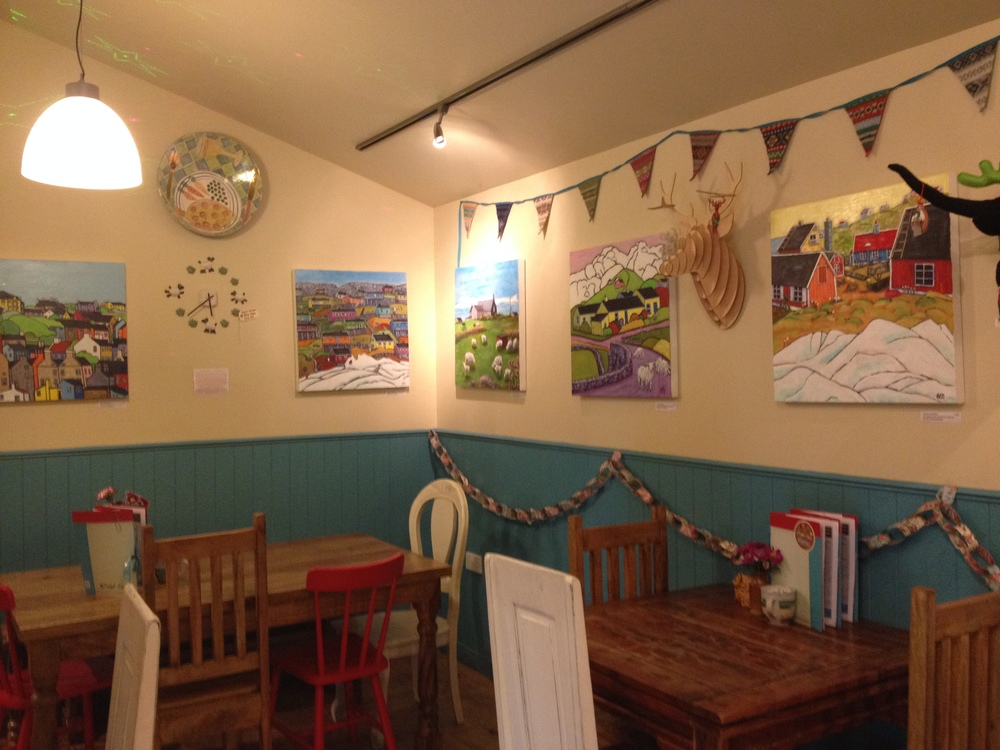 My paintings hanging in Judith Glue's shop in Kirkwall, Orkney-Christmas 2013.