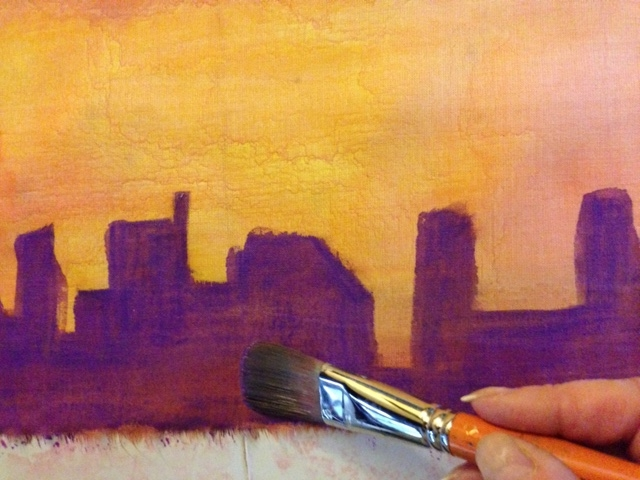 Painting some darker purple behind the red sinamay buildings added some depth and shadowing.