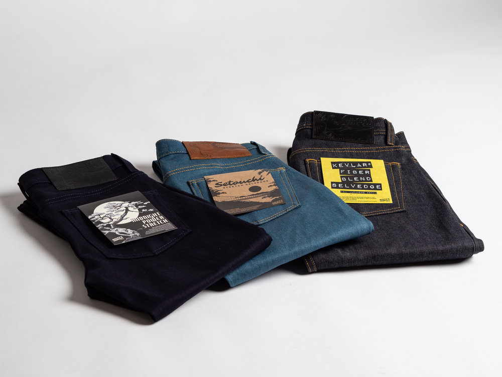 NAKED & FAMOUS SEASONAL DENIM - New from Naked & Famous : their first seasonal denim drop, featuring the Guardian Selvedge, Setouchi Stretch Selvedge and Midnight Power Stretch. The Guardian Selvedge features 10% real Kevlar (5 times stronger than steel!) for increased durability and strength. It will pick up a yellowy hue through wash and wear as the indigo fades and the yellow Kevlar fibers are exposed. The Midnight Power Stretch layers indigo warp yarns over black weft yarns for a super dark, midnight blue tone. The Setouchi Stretch Selvedge takes inspiration for its blue from the Setouchi Sea, bordering Kojima, Japan, famed for its denim and textiles industry. Naked & Famous' denim is all milled in Japan and the garments are all assembled in their own facilities in Montreal.