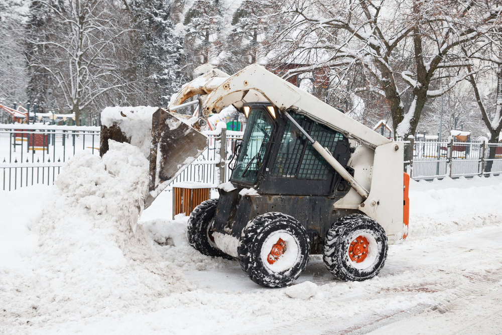 Small-Excavator-Bobcat-Working-39934351.jpg